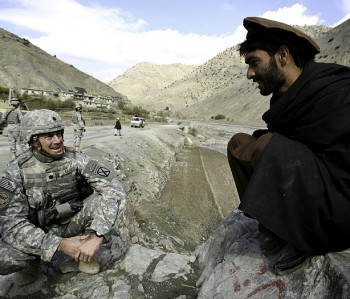 Soldier converses with Afghani local
