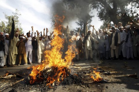 Afghans burn an effigy of U.S. pastor Terry Jones during a protest along the Kabul-Jalalabad highway