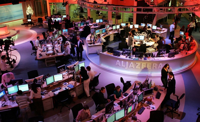 Staff work at the English-language newsroom at the headquarters of the Qatar-based Al Jazeera satellite channel in Doha