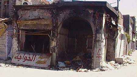 Burnt building in Homs