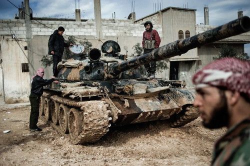 A_Free_Syrian_Army_member_prepares_to_fight_with_a_tank