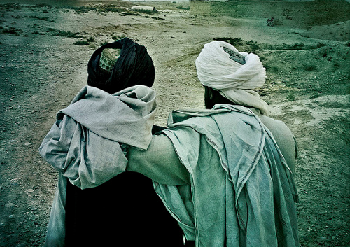Afghan men by balazsgardi / Creative Commons