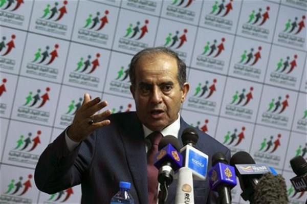 Mahmoud Jibril, head of the National Forces Alliance, talks during a news conference at his headquarters in Tripoli