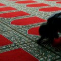 A Muslim Imam during prayer at a Mosque.