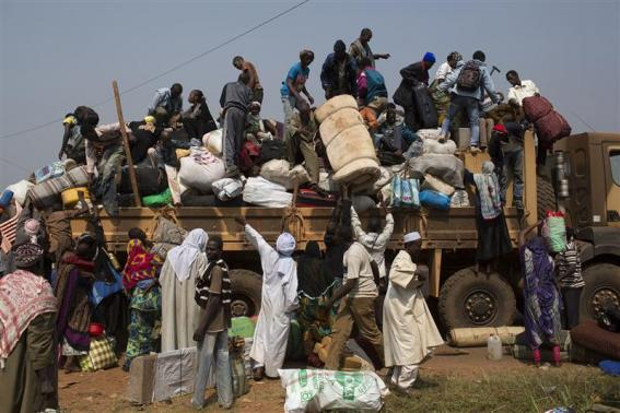 People load their belongings onto a truck as they prepare to leave during a repatriation by road to Chad at the capital Bangui