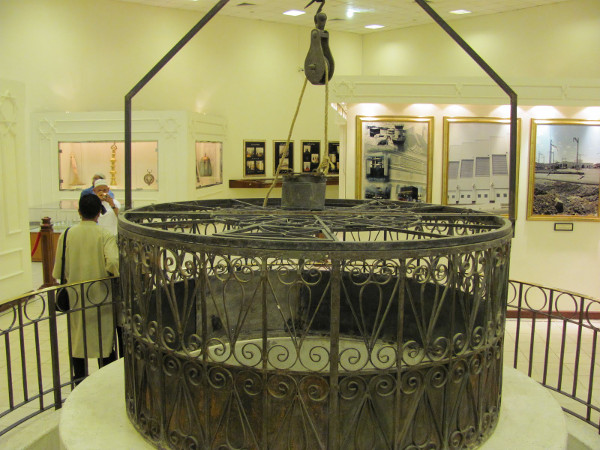 The previous rails and bucket of the Zamzam well, now in a museum.