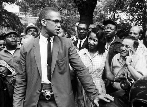 Malcolm X promoting Black Muslim policies during civil rights demonstration on street..  (Photo by Bob Henriques//Time Life Pictures/Getty Images)